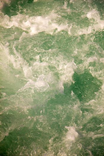 Water surface as a background with foam and bubbles