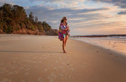 Female relaxed morning walks along the beach