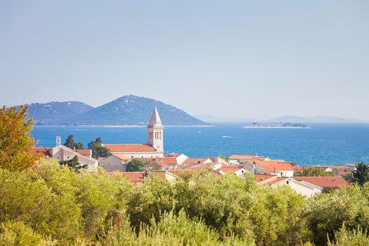 Pakostane, Zadar, Croatia, Europe - Steeple of Pakostane at the coastline of Zadar