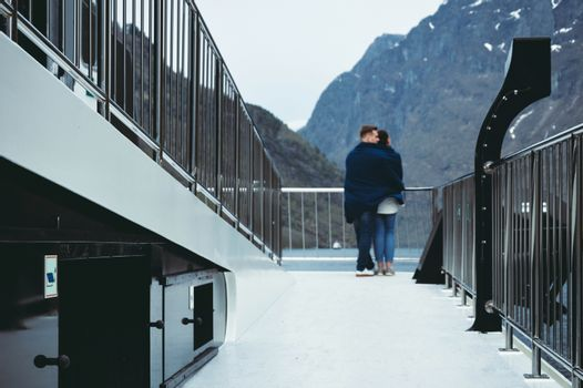 A couple of tourists travels on board a ferry boat