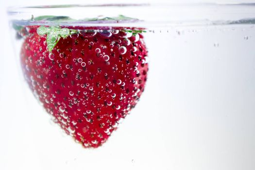 Strawberry Skinny Dipping in a Glass of Fizzy Water
