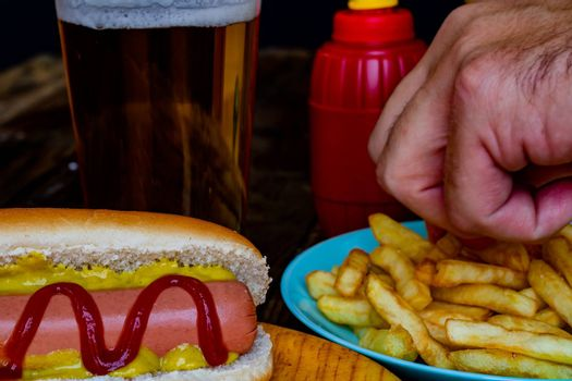 Hot dog and chips on wooden background