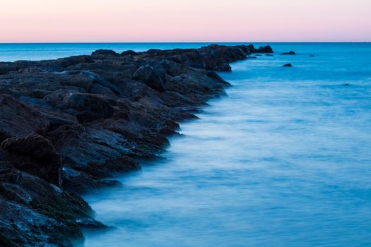Breakwater at Burriana beach in long exposure