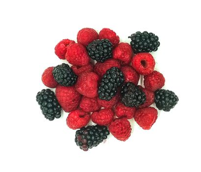 blackberries and raspberries in composition on white background