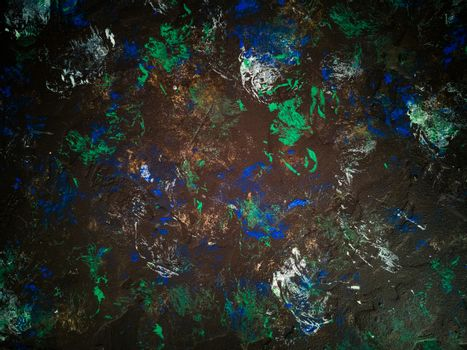 Rugged black background with green and blue blots