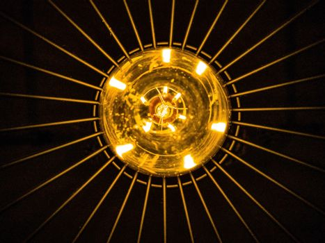 View from below of a bulb on a black background