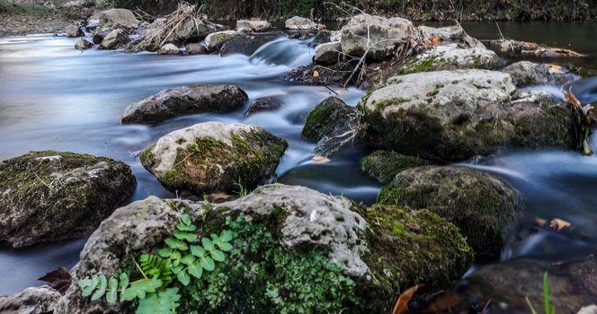 Palancia river water flowing through rocks in long exposure