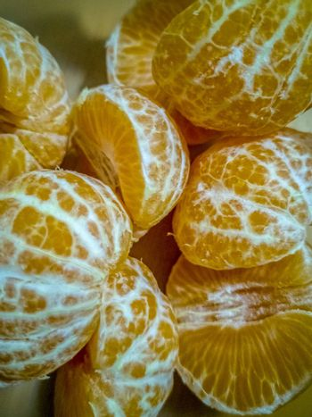 View of peeled small oranges piled up