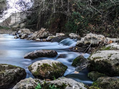 Palancia river waters flowing through the rocks in long exposure