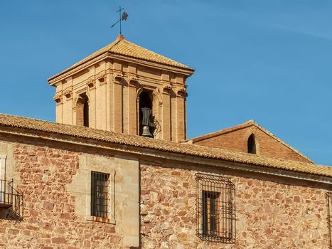 Bell tower of the monastery with blue sky