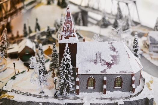 miniature city in winter - with houses, roads, cars, railway