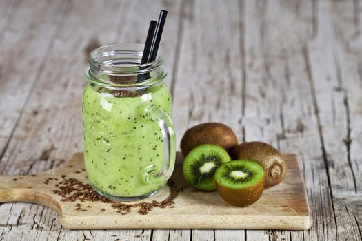 Green smoothie with kiwi, apple, lemon and linen seeds. Healthy