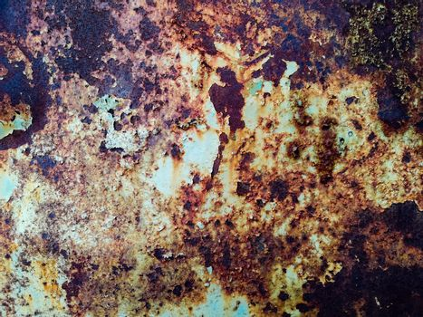 Rusty metal background with rough texture in brown tones