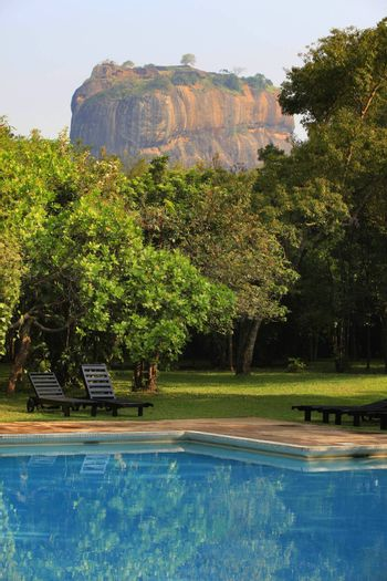 The historical Sigiriya rock fortress is surrounded by a breathtaking landscape