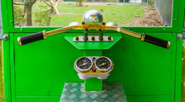 the cockpit of a rickshaw, children toys, steering wheel with speedometer