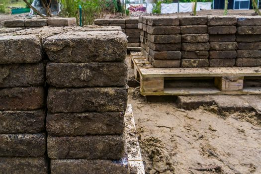 piles of paving stones on pallets, construction industry background
