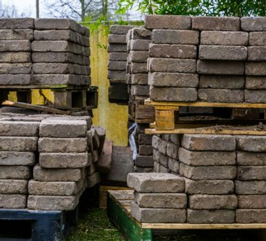 stacked pallets with paving stones, construction materials, pavement industry