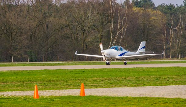 white airplane landing, recreational air transportation, aircraft landing at the airport