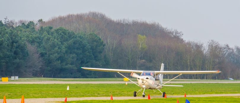 white stunt airplane driving by, recreation sport and hobby, plane at the airport