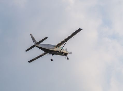 recreational airplane flying with cloudy weather, air transportation, hobby and sports