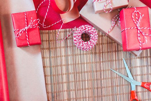 Preparing for the holiday - gift wrapping in red and beige wrapping paper