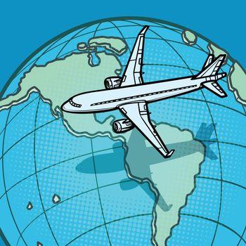 plane flies over globe America