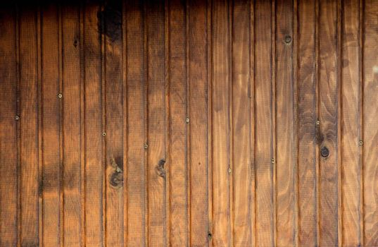 Texture details of an old wooden plunks as background