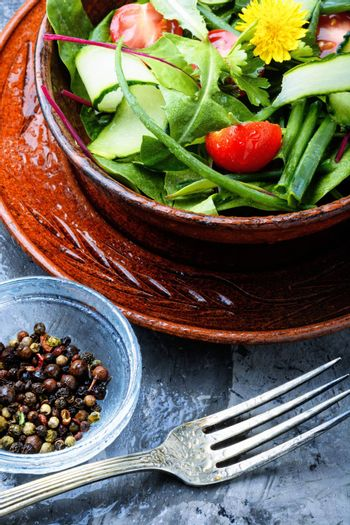 Healthy vegetable salad of fresh tomato, cucumber, herb and lettuce