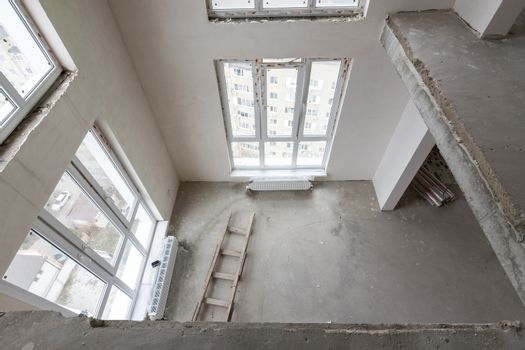 View from the second floor to the first floor in a two-story apartment in a new building