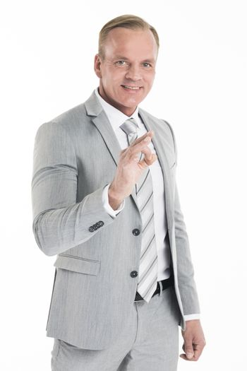 Mature businessman doing ok sign, isolated over white background
