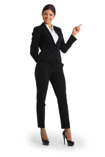 Businesswoman pointing with finger at empty copy space, studio isolated on white background, full length portrait