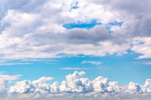 Beautiful cumulus clouds in a blue sky