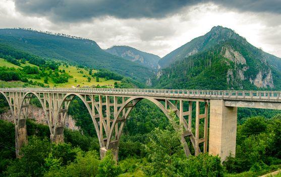 Beautiful Djurdjevica Bridge over River Tara Canyon. Durmitor National Park in Montenegro, Balkans, Europe