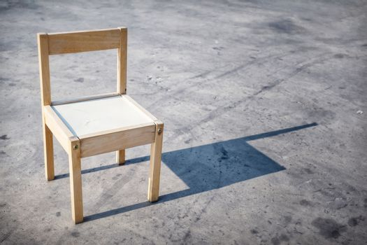 Small Wooden Chair in the Sunlight