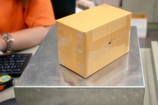Shipping Box on a Industrial Weight Scale in a Office