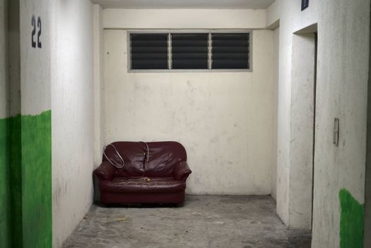 sofa or armchair abandoned to rest while waiting for the elevator