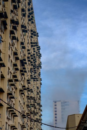 mosquito repellent fumigation on housing building high-rise blocks complex to avoid dengue - along side view