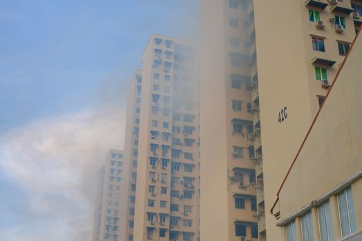mosquito repellent fumigation on housing building high-rise blocks complex to avoid dengue - far street view