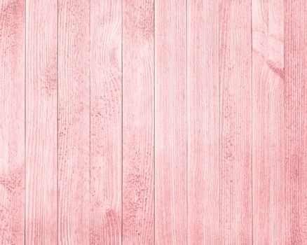 Vintage red hue wooden table background top view.