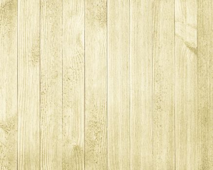 Vintage yellow wooden table background top view.