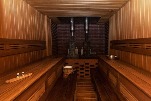 Russian sauna interier with accessories: wooden basins, scoops