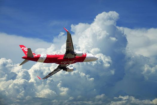 Kota Kinabalu, Malaysia - January 03, 2015: Passenger airplane Airbus A320 flying travel, trip at flight level over the white clouds