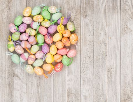 Happy Easter colorful foam eggs on a wooden background.
