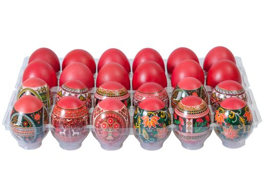 Red Easter eggs in egg carton isolated on a white background.