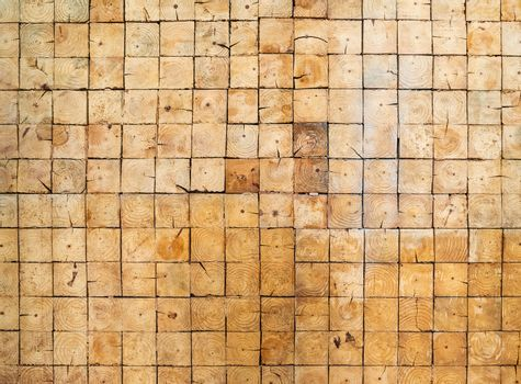 Detail and texture of a wall made of square wood blocks