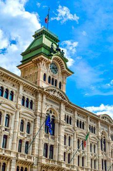 Municipio clock tower building of Trieste in Piazza Unita Italia Italy vertical landmark background .