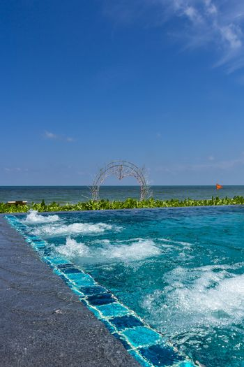An infinity pool with jacuzzi at a beach resort in Phu Quoc