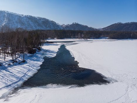 Aerial view of winter blue lakes in Altai mountains