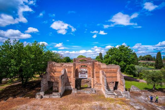 Tivoli - Villa Adriana cultural Rome tour- archaeological landmark in Italy aerial view of the Three Exedras building .