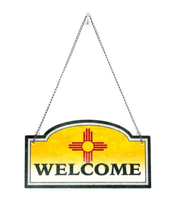New Mexico welcomes you! Old metal sign isolated